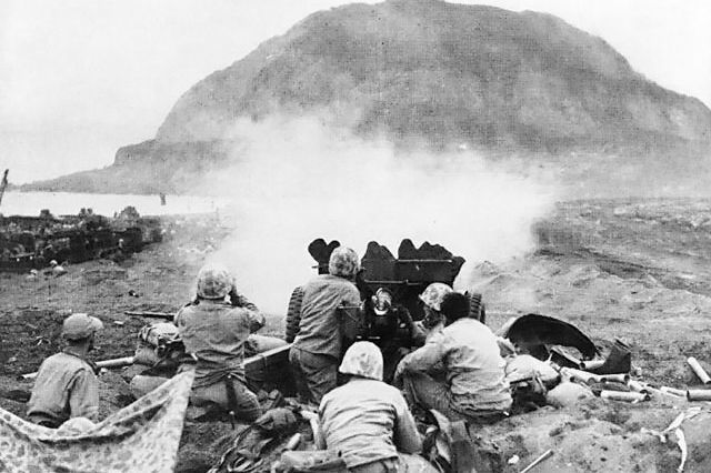 gallery-1466451502-37mm-gun-fires-against-cave-positions-at-iwo-jima.jpg